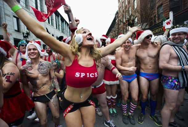 """Runners gather at the start line for the annual """"Santa Speedo Run,"""" a charity race through the streets of the Back Bay neighborhood of Boston"""